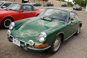 Irish Green Porsche 912 in a parking space.