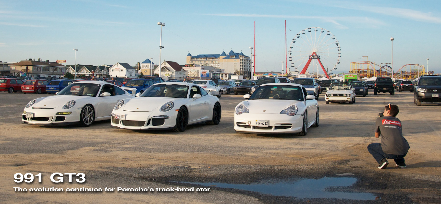 gt3 line up from h2oi car show with someone talking a picture