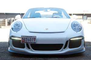 Front profile view of the 991 GT3 in the parking lot with contrasting light