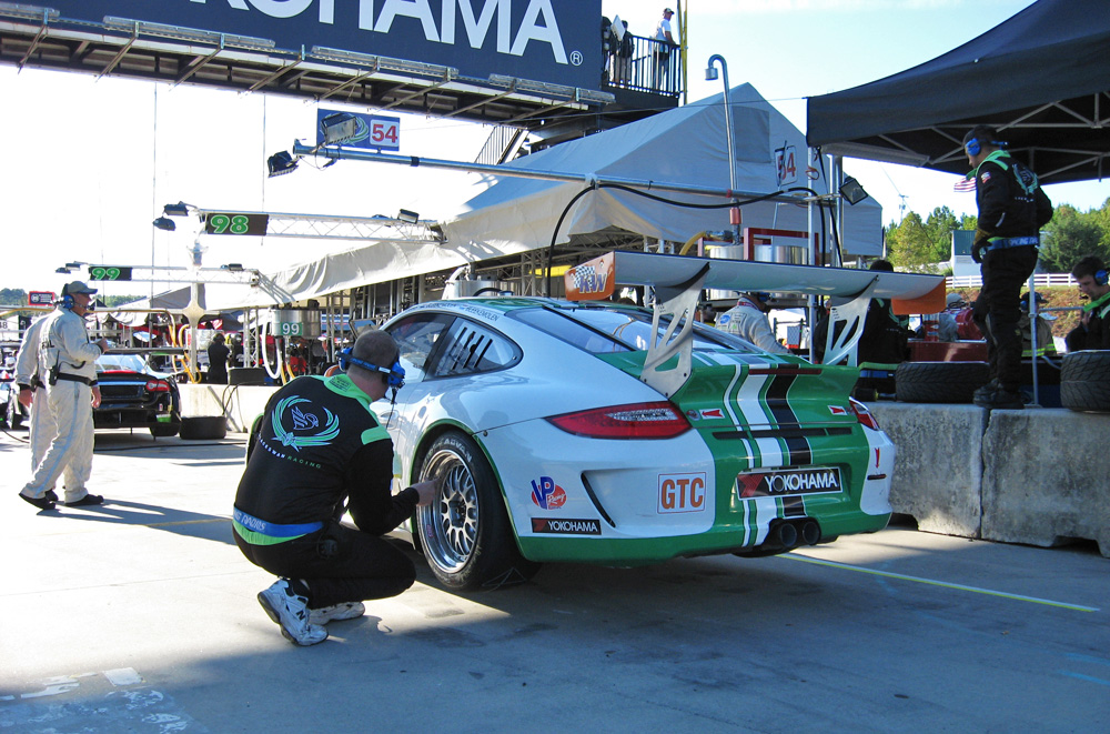 The Black Swan Racing Porsche 911 GT3 cup being worked on in put lane at Road Atlanta.