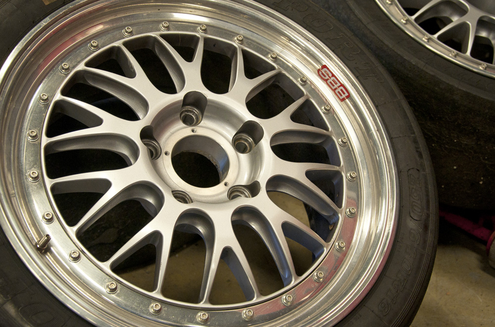 A close up picture of BBS wheels with slick tires