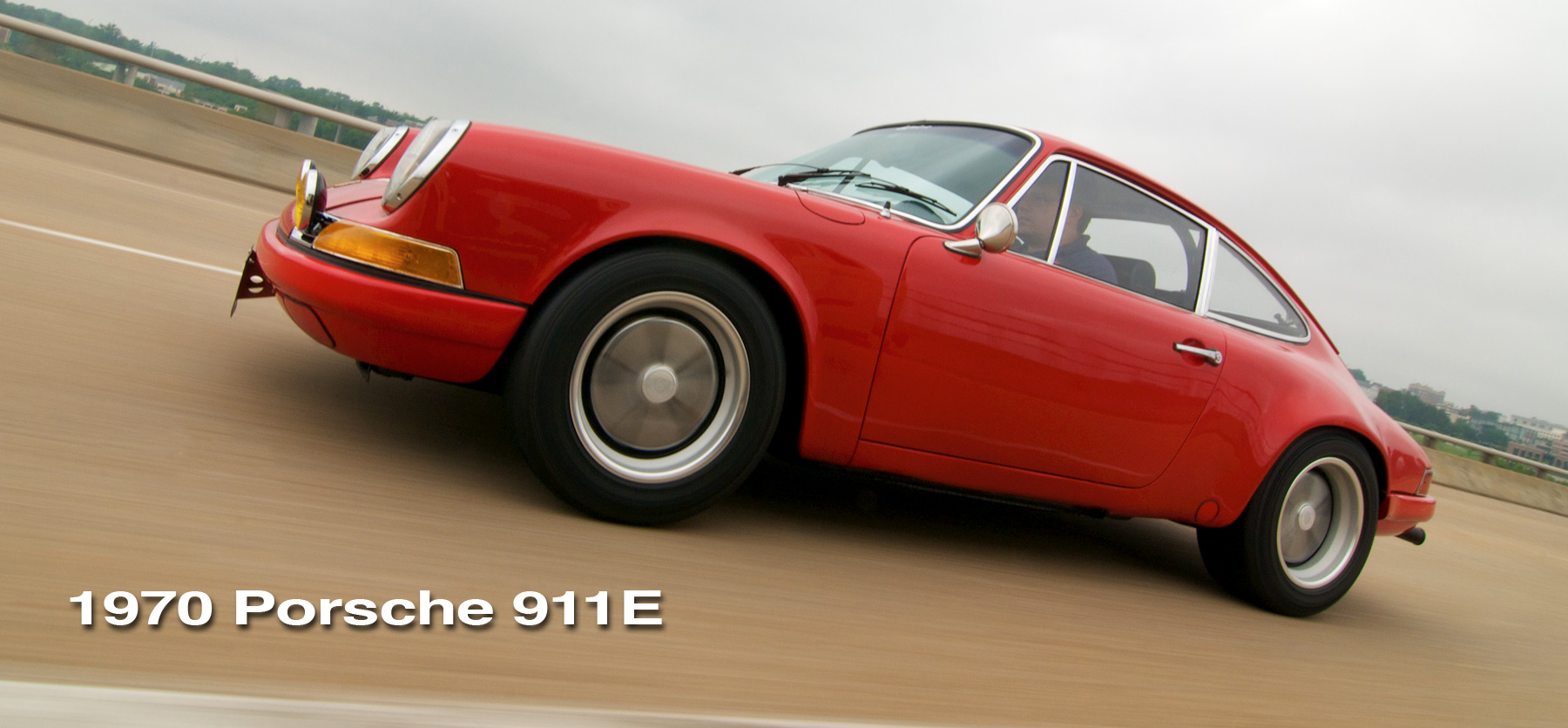 Red 911E header image with a clean panning shot