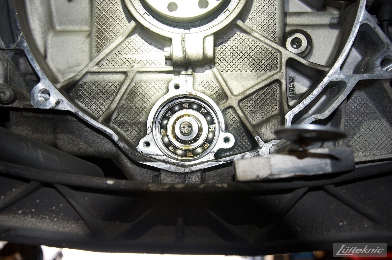 A picture of an M96 996 engine IMS bearing with the seal removed, exposing the bearing cage and bearings.