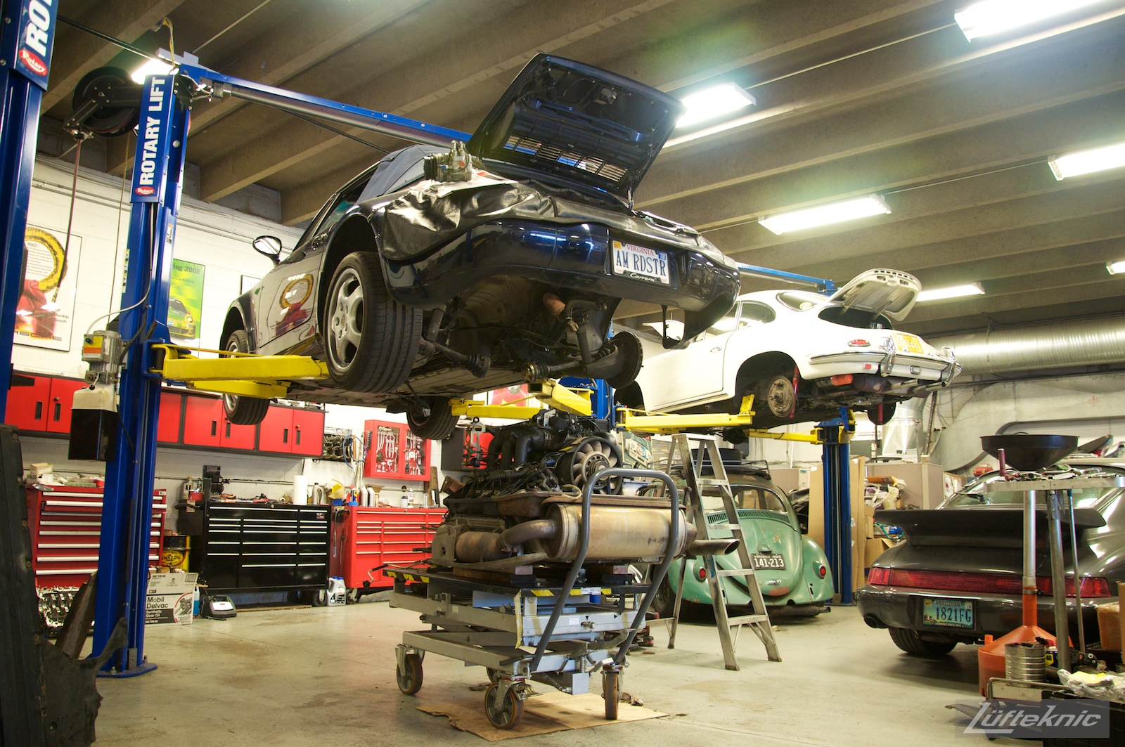 A rare 964 American Roadster inside the Lufteknic shop with the engine and transmission being removed.