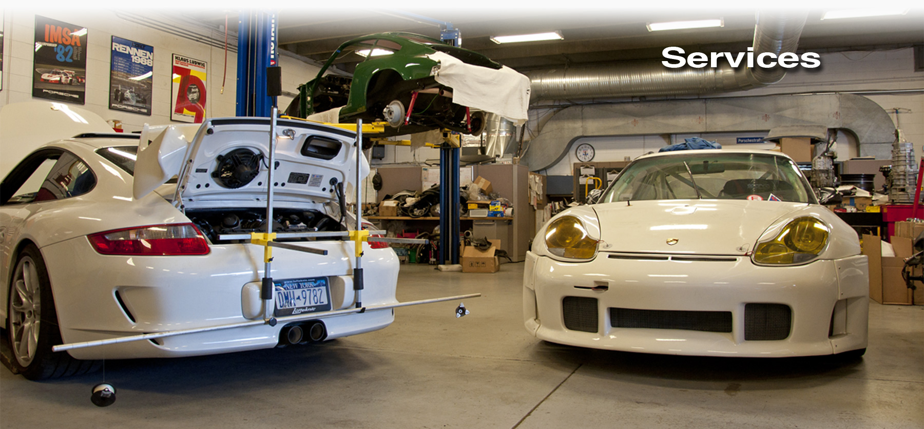 Lüfteknic services header showing a 997 GT3, 912 and 996 RSR being worked on inside Lüfteknic.