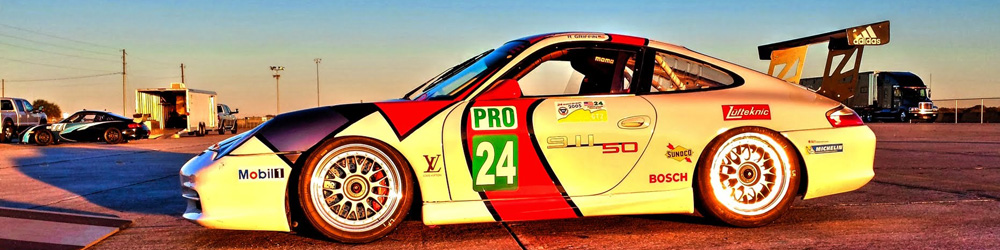 A 996 GT3 Cup with Lufteknic logo in the setting sun parked at Sebring racetrack