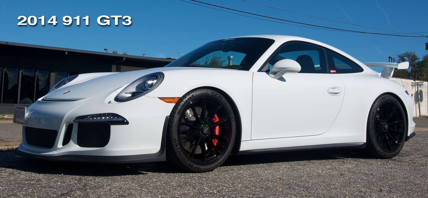 Header image for the 991 GT3 project showing the car from a low angle.