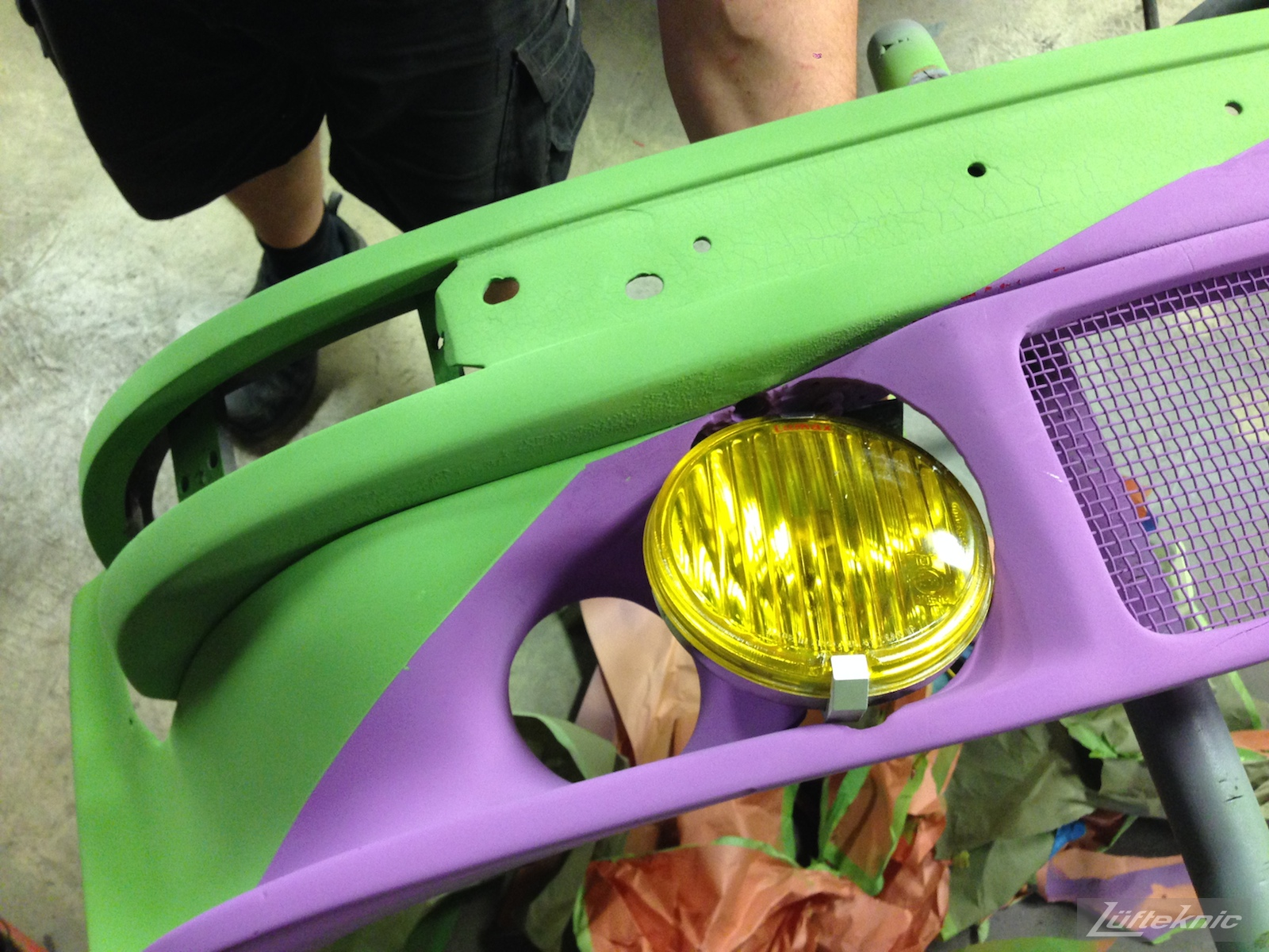 Lüfteknic #projectstuka Porsche 930 Turbo bumper with yellow fog light held in place.
