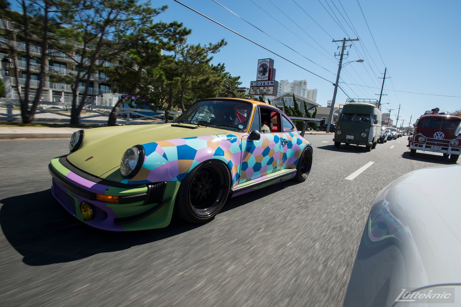 Lüfteknic #projectstuka Porsche 930 Turbo driving down the street with vintage vw buses.