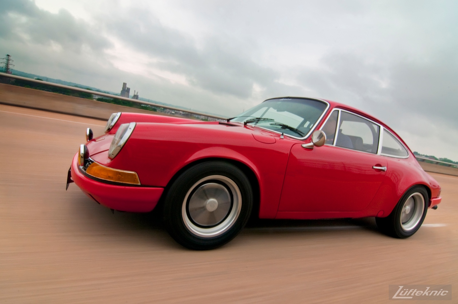 A pacing shot of a red 911E