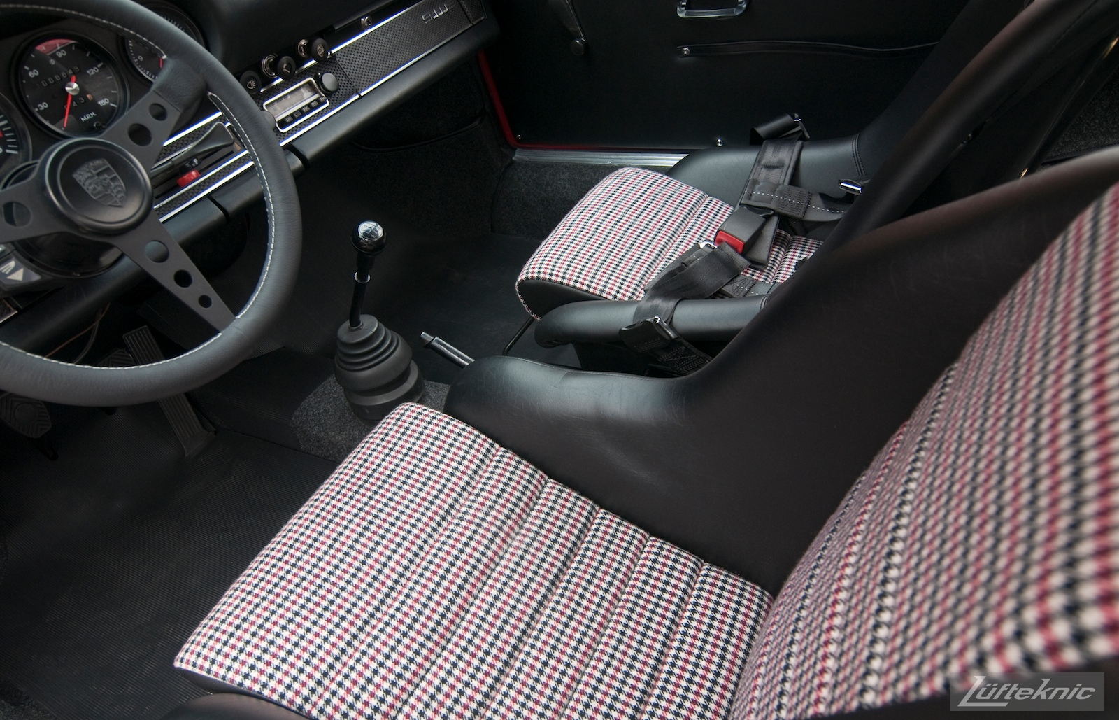 Porsche sport bucket seats with houndstooth pattern