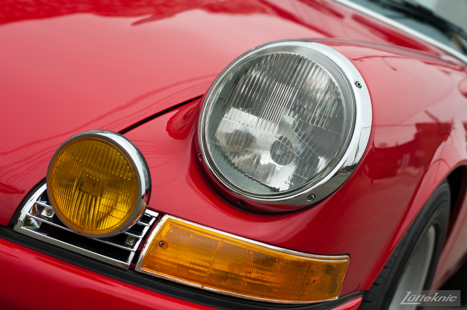 Detail shot of a fender and light on a 1970 911E