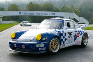 A porsche 964 RSR replica on the front straight at Lime Rock Park.