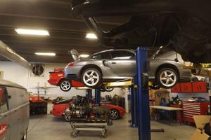 Porsche cars being serviced