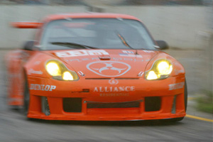 A blurred picture of the Hazardous Sports Porsche GT3 Rs in orange