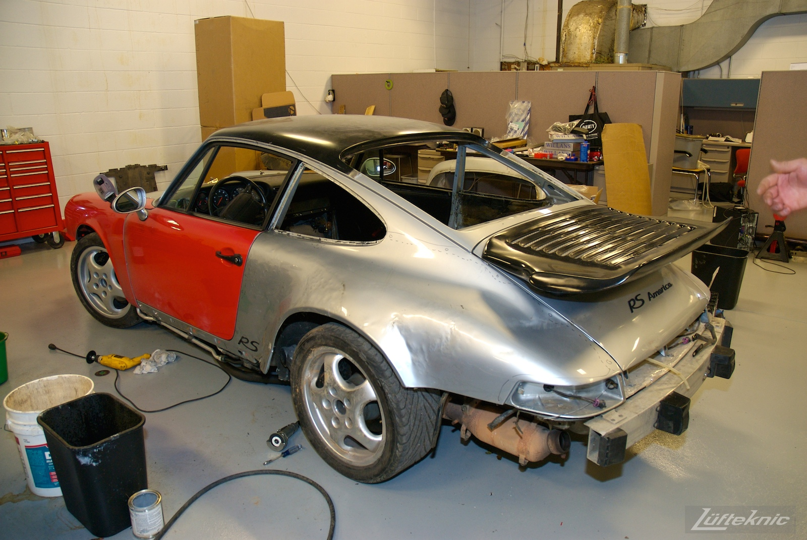 Replacement panels on a wrecked 964 RS America inside the Lüfteknic shop