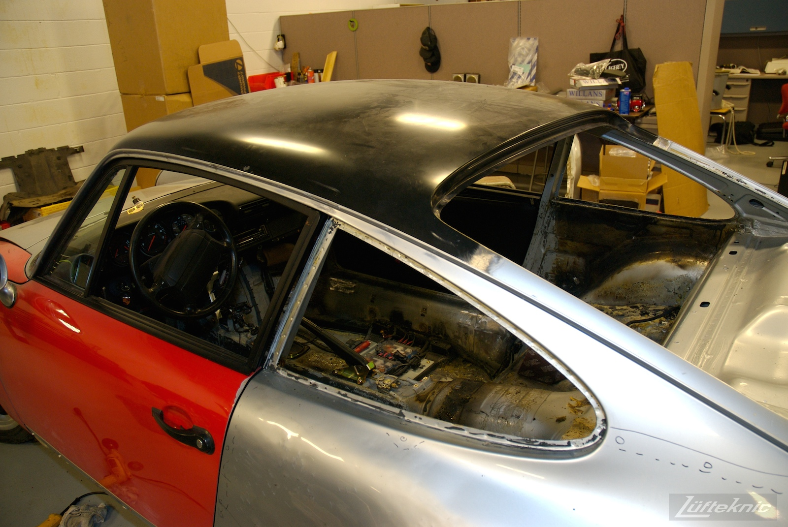 A brand new roof installed onto a wrecked Porsche 964 RS America