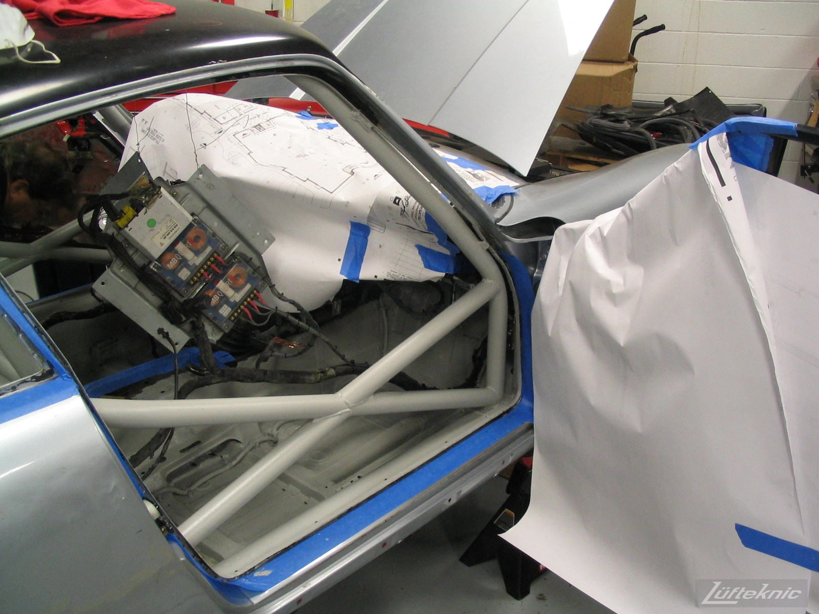 Roll cage has been installed and painted on the 964 RS America project, shown with no seats.