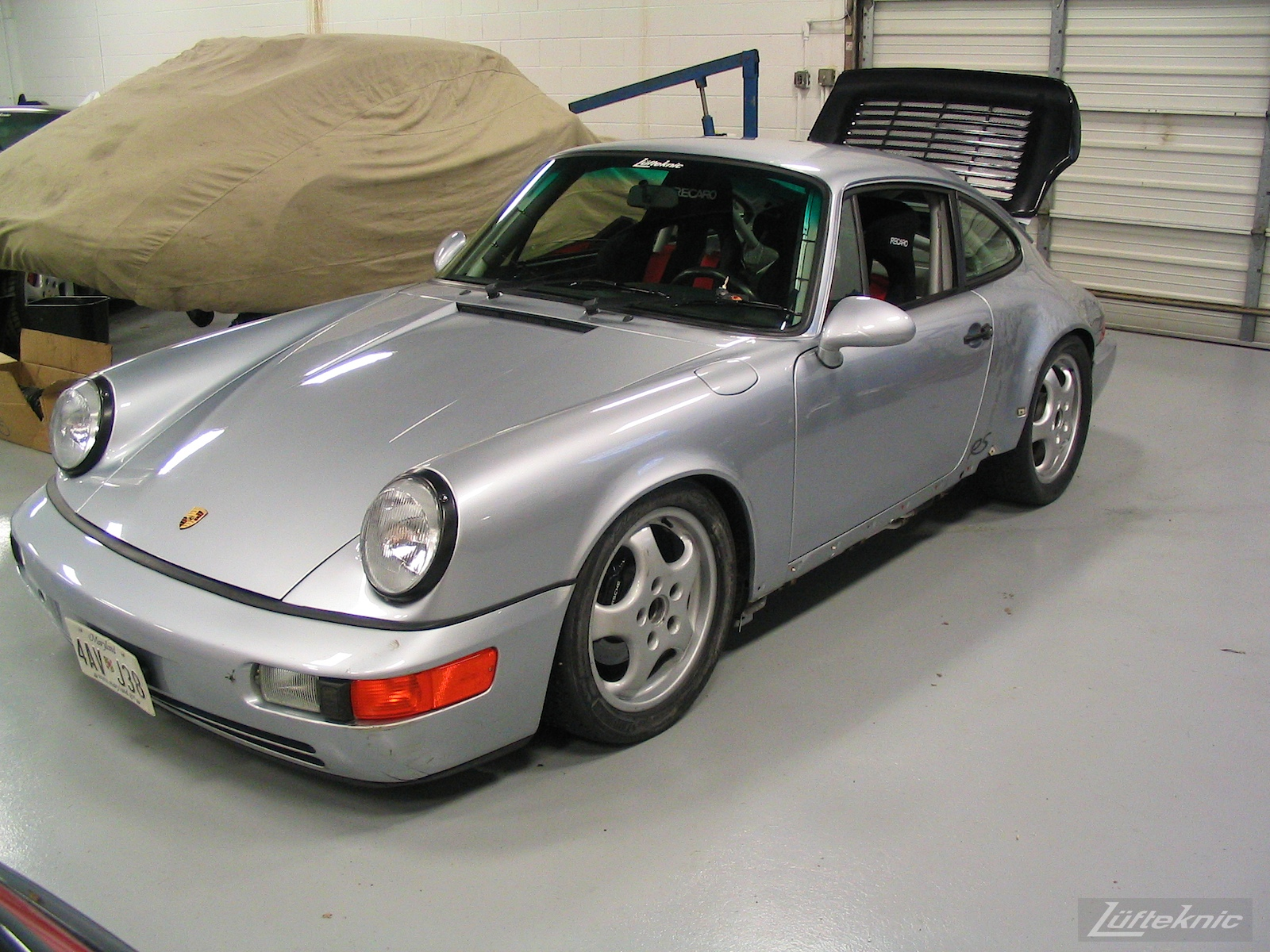 Roll cage, seats, harness installed and fresh paint shown on the 964 RS America.