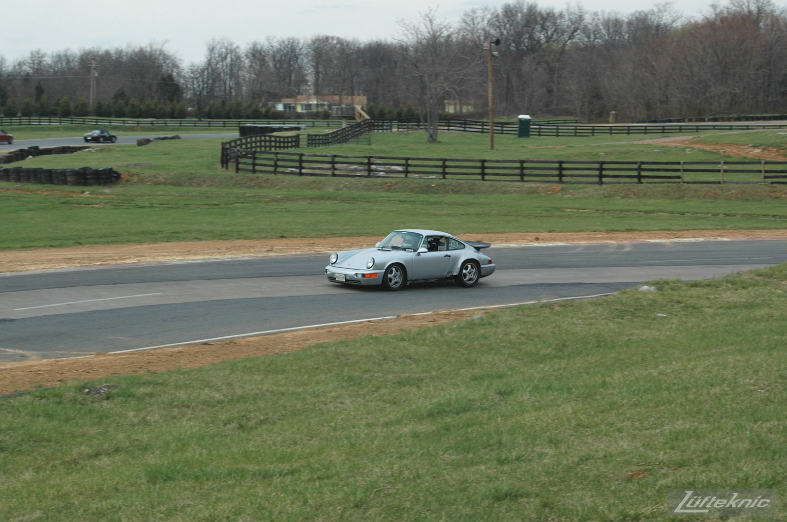 The 964 RS America on track for the first time after the accident going around a left hand corner.