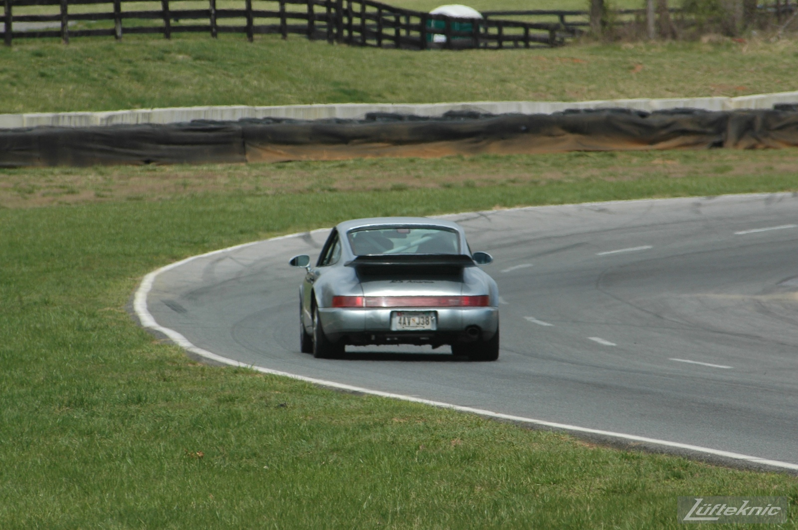 The 964 RS America on track for the first time after the accident, going down the hill at Summit Point