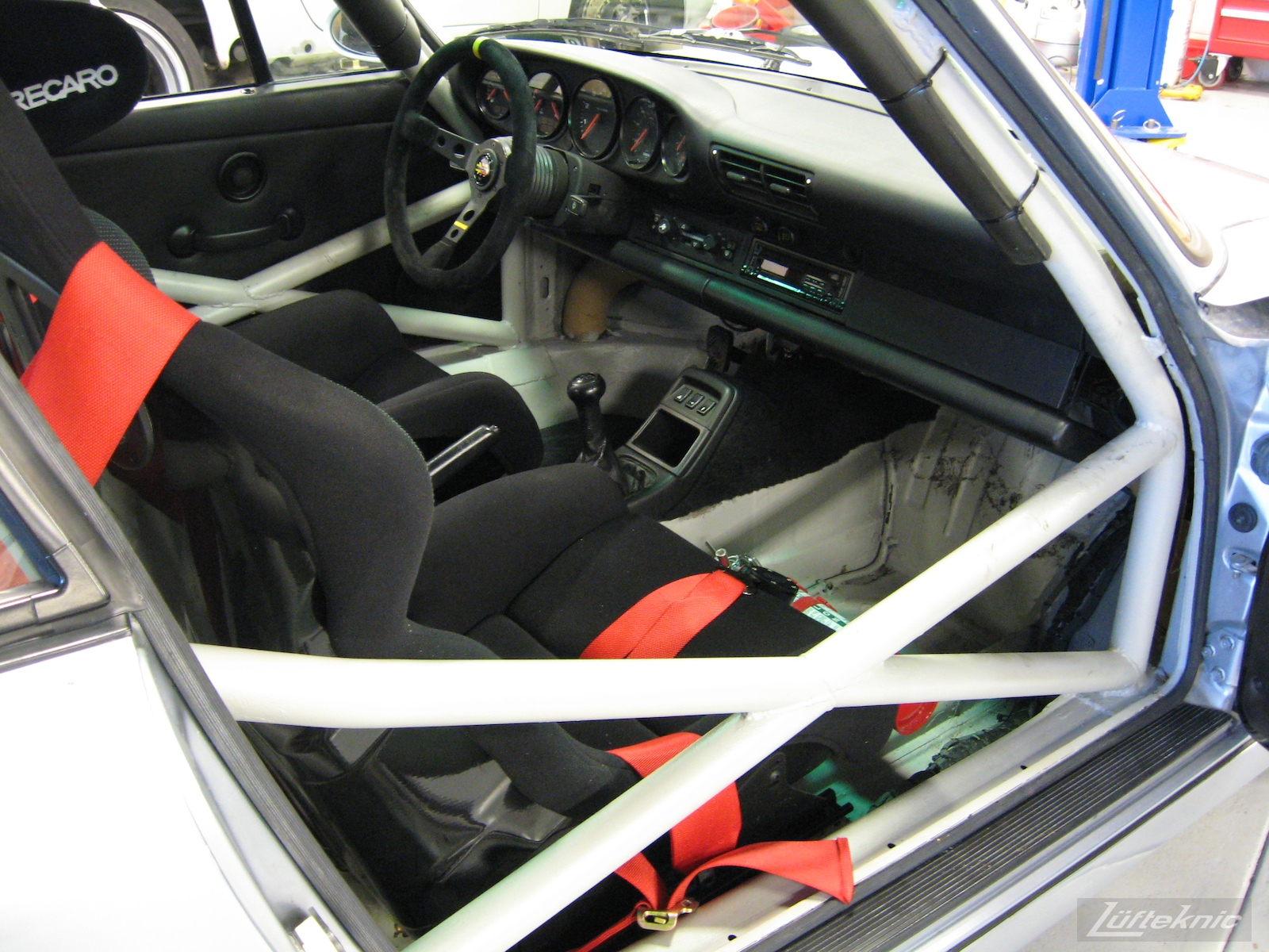 The completed 964 RS America project showing the safety cage, seats and fire extinguisher.
