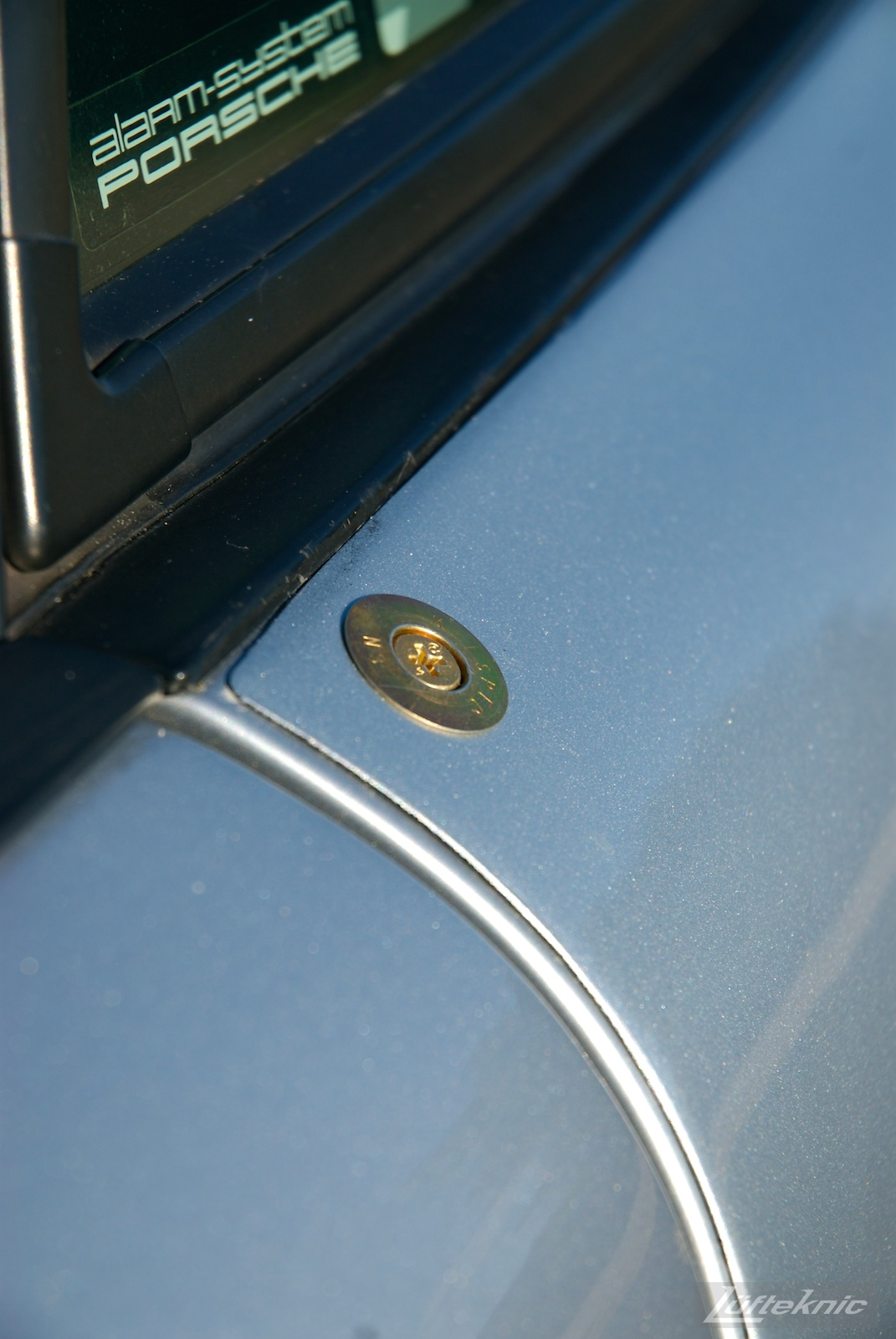 A detailed photo of a cam lock fastener on the side of the RS America.