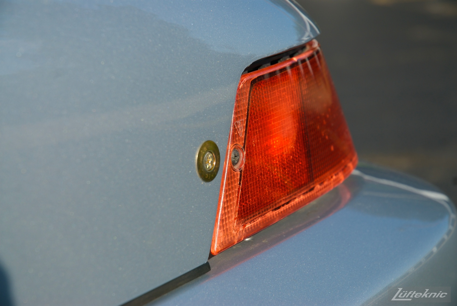 Worn rear tail light and cam lock faster detail shot on the 964 RS America