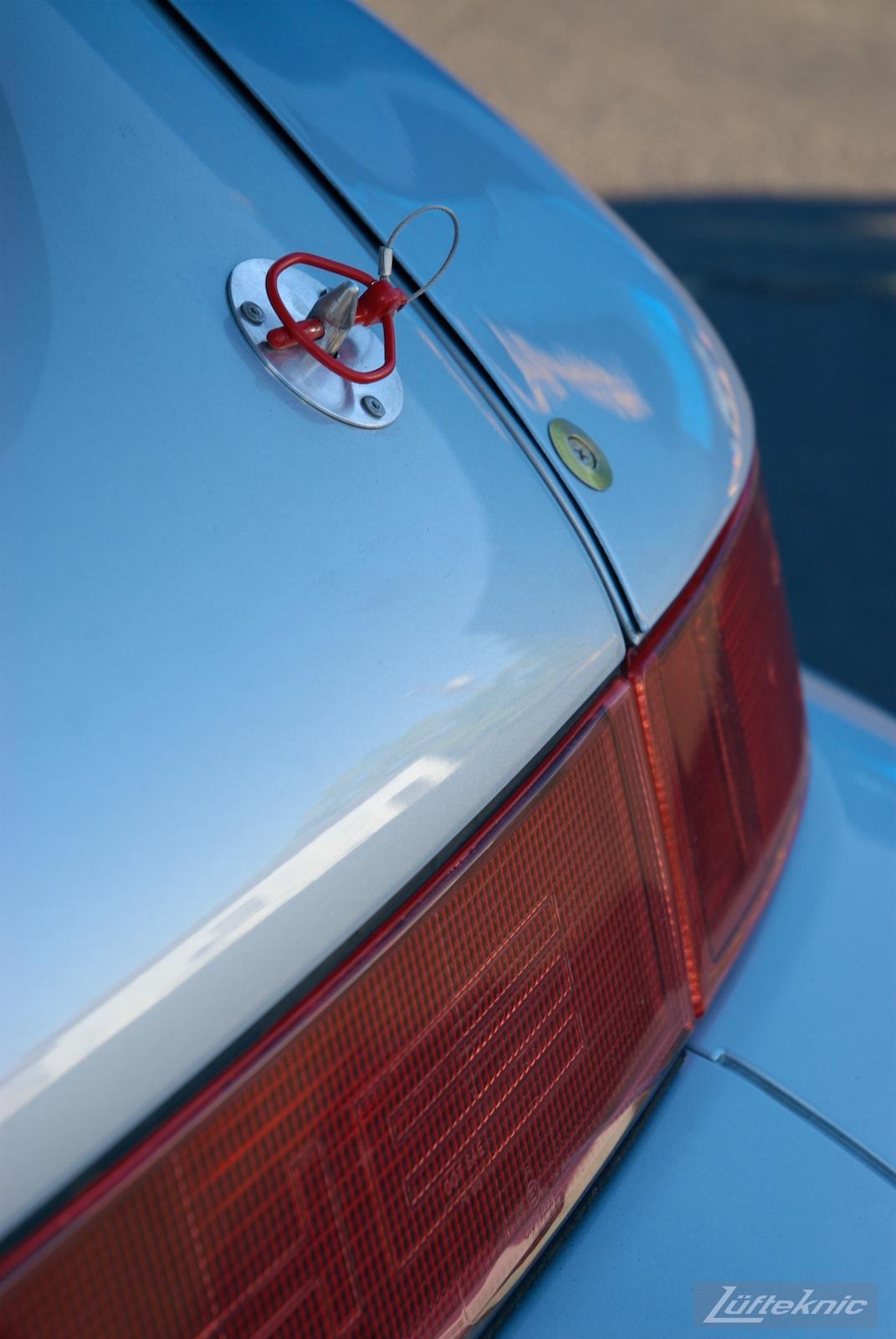 Detailed photo showing the RSR Porsche rear decklid fasteners.
