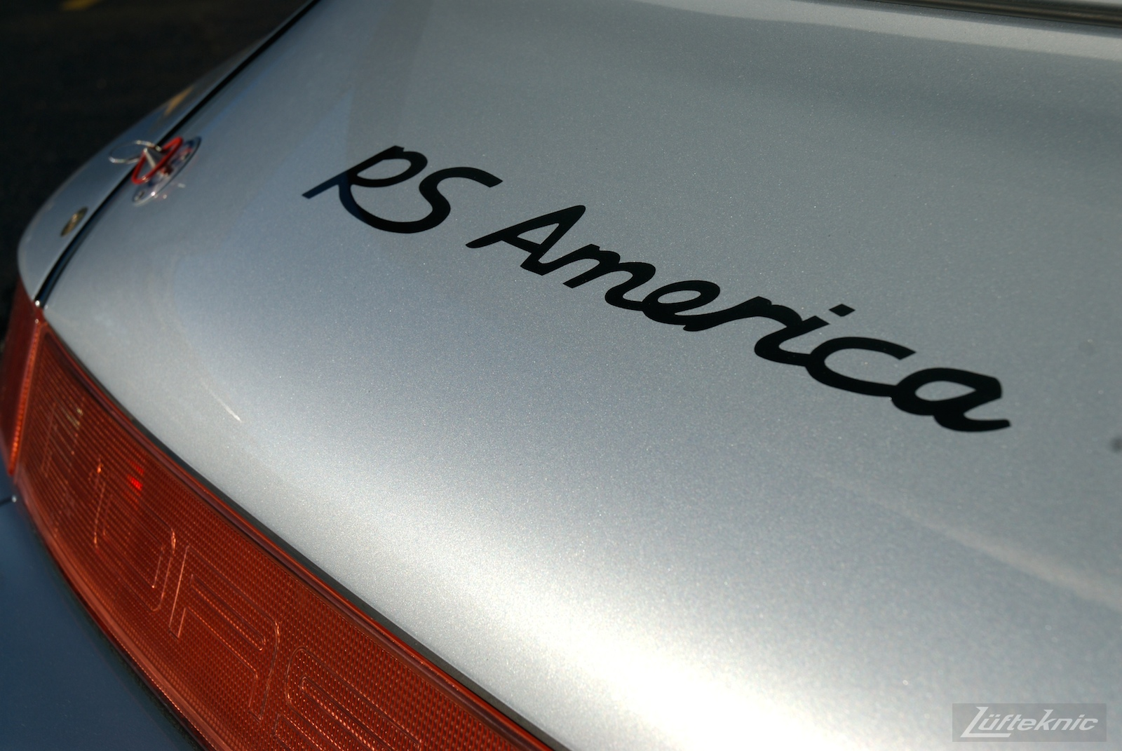 RS America graphics painted onto the rear decklid.