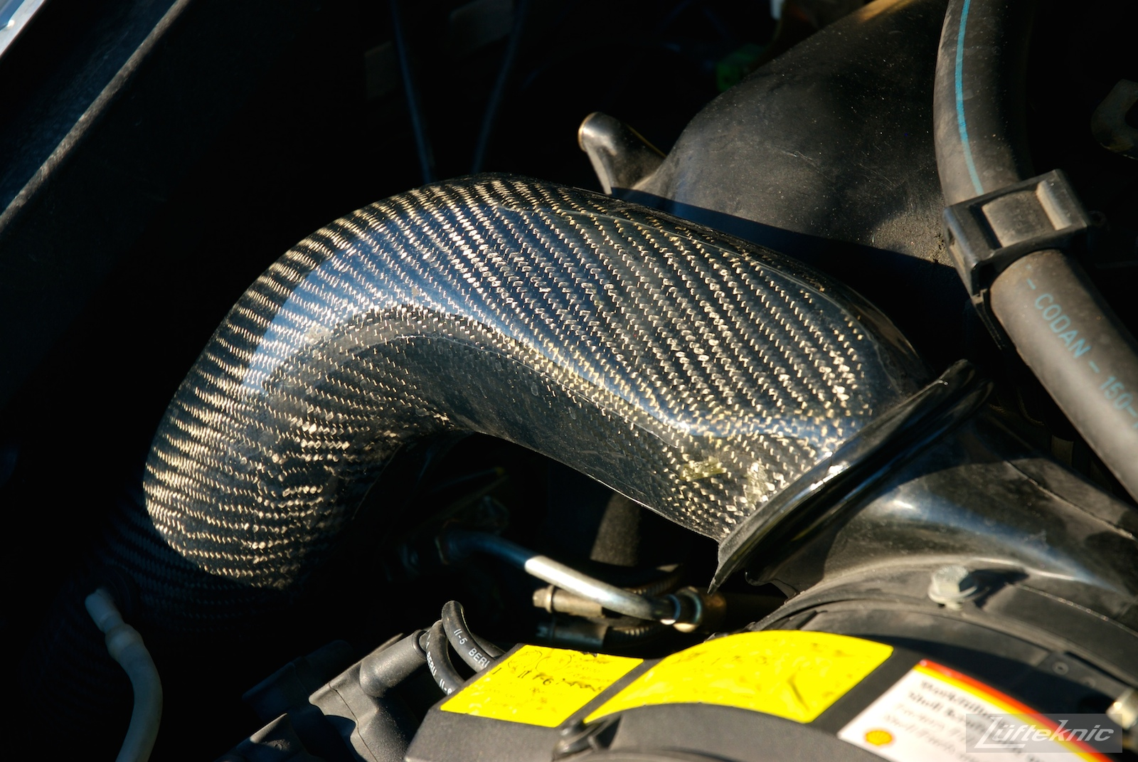 Carbon fiber engine heater pipe shown on the RS America.