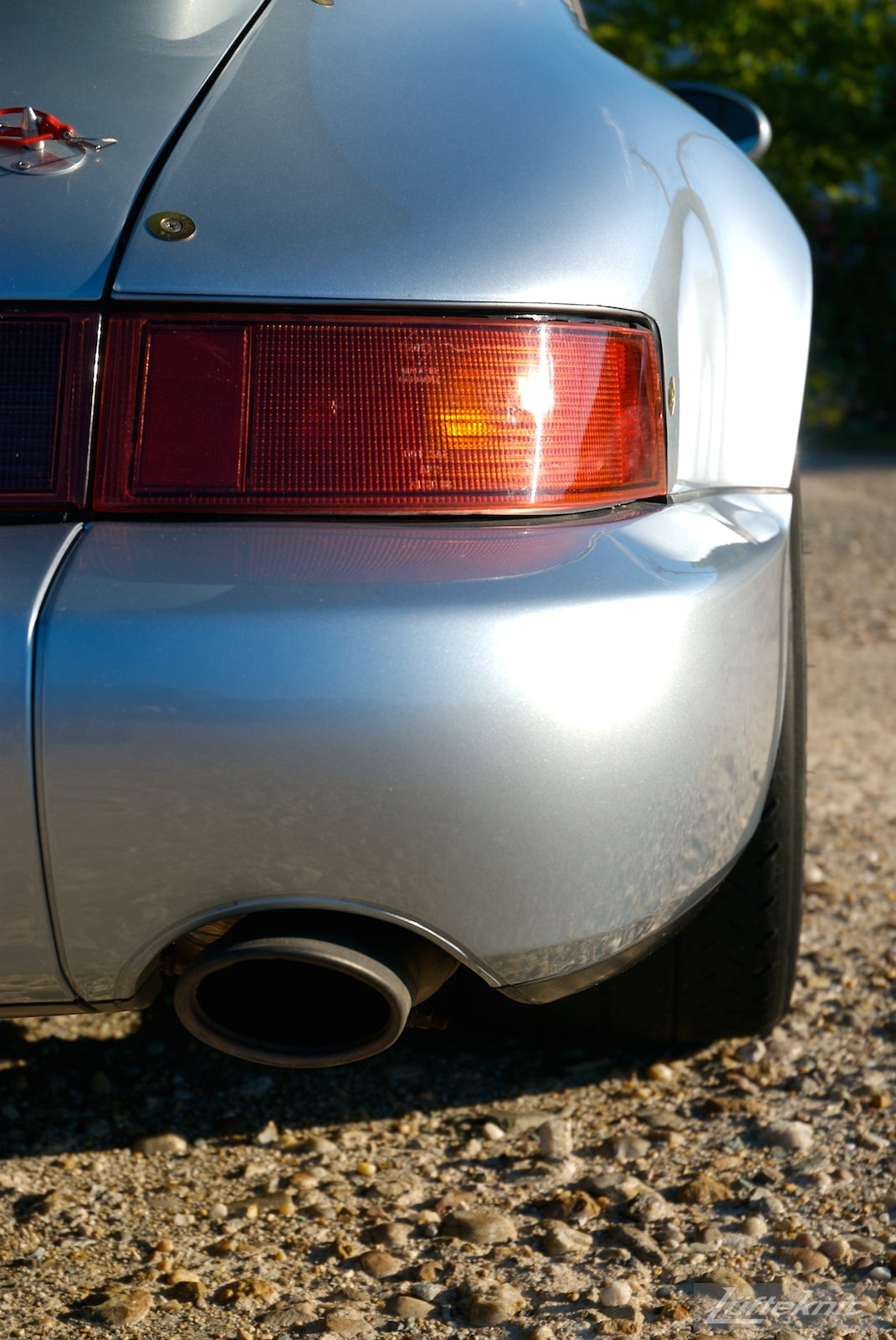 A rear detail shot of the bumper and exhaust tip on the 964 RS America.
