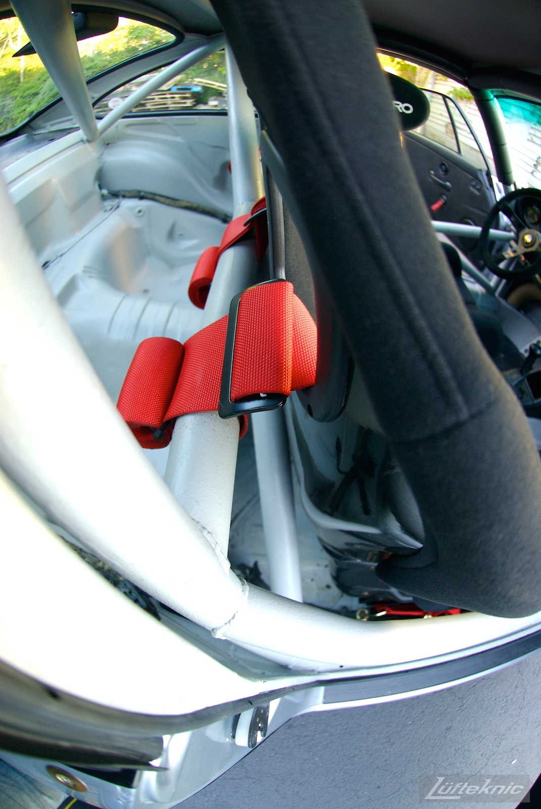 Track prepped Porsche 964 RS America roll cage and harnesses.