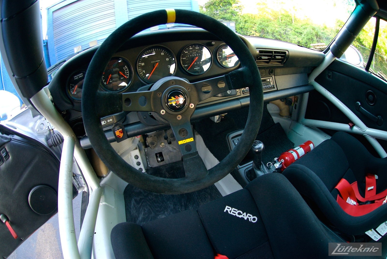 Track prepped Porsche 964 RS America Momo steering wheel.