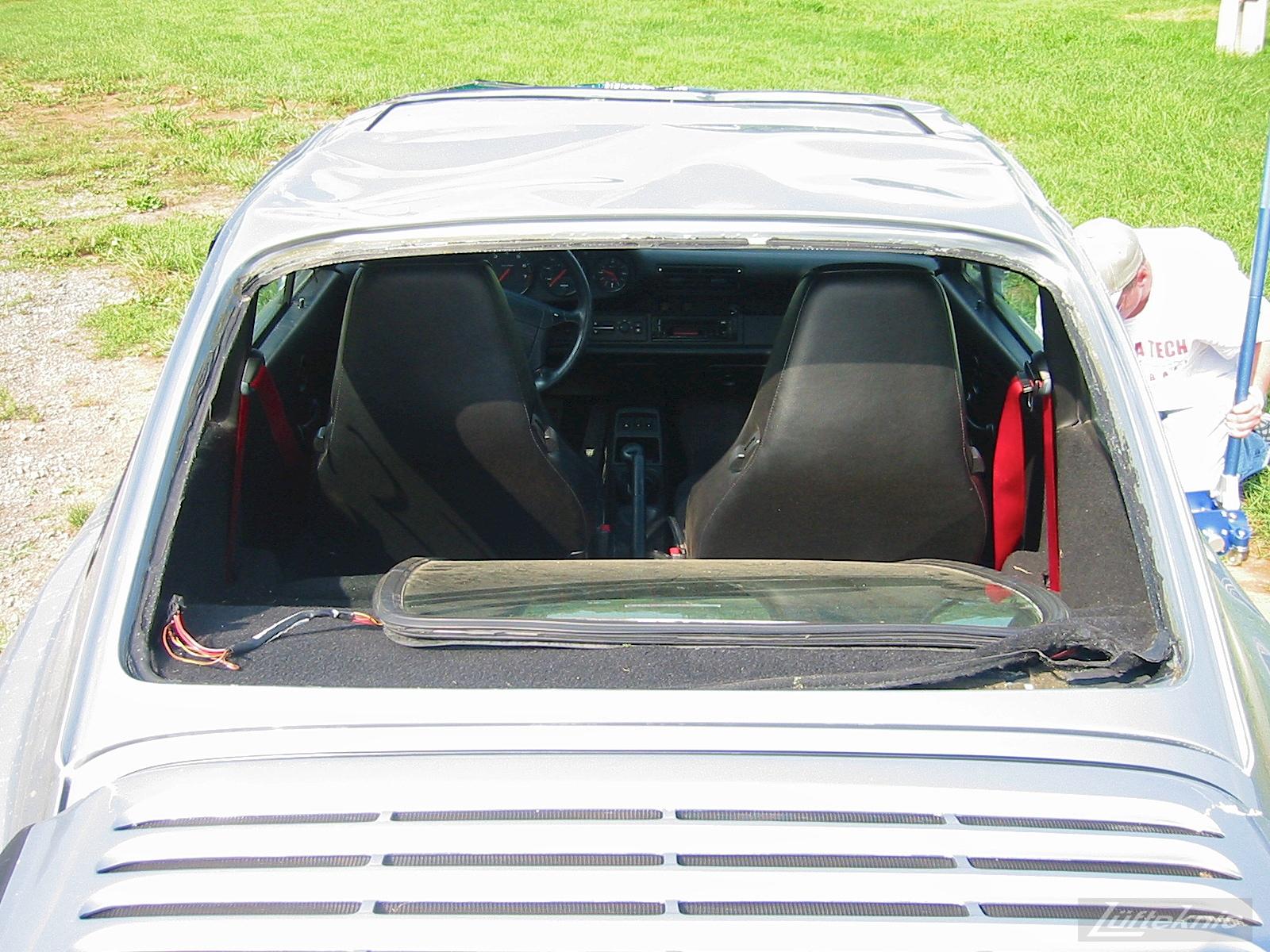 Freshly wrecked Porsche 964 RS America with broken windows
