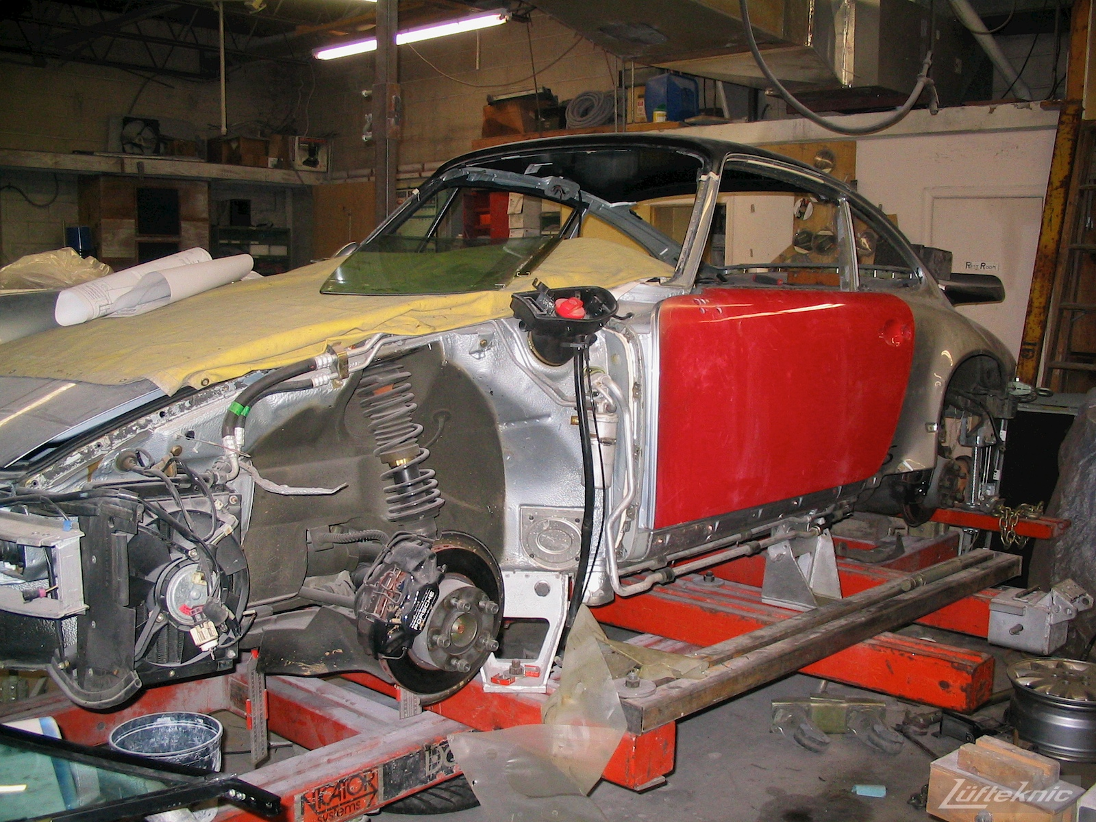 Wrecked Porsche 964 RS America on the frame rack