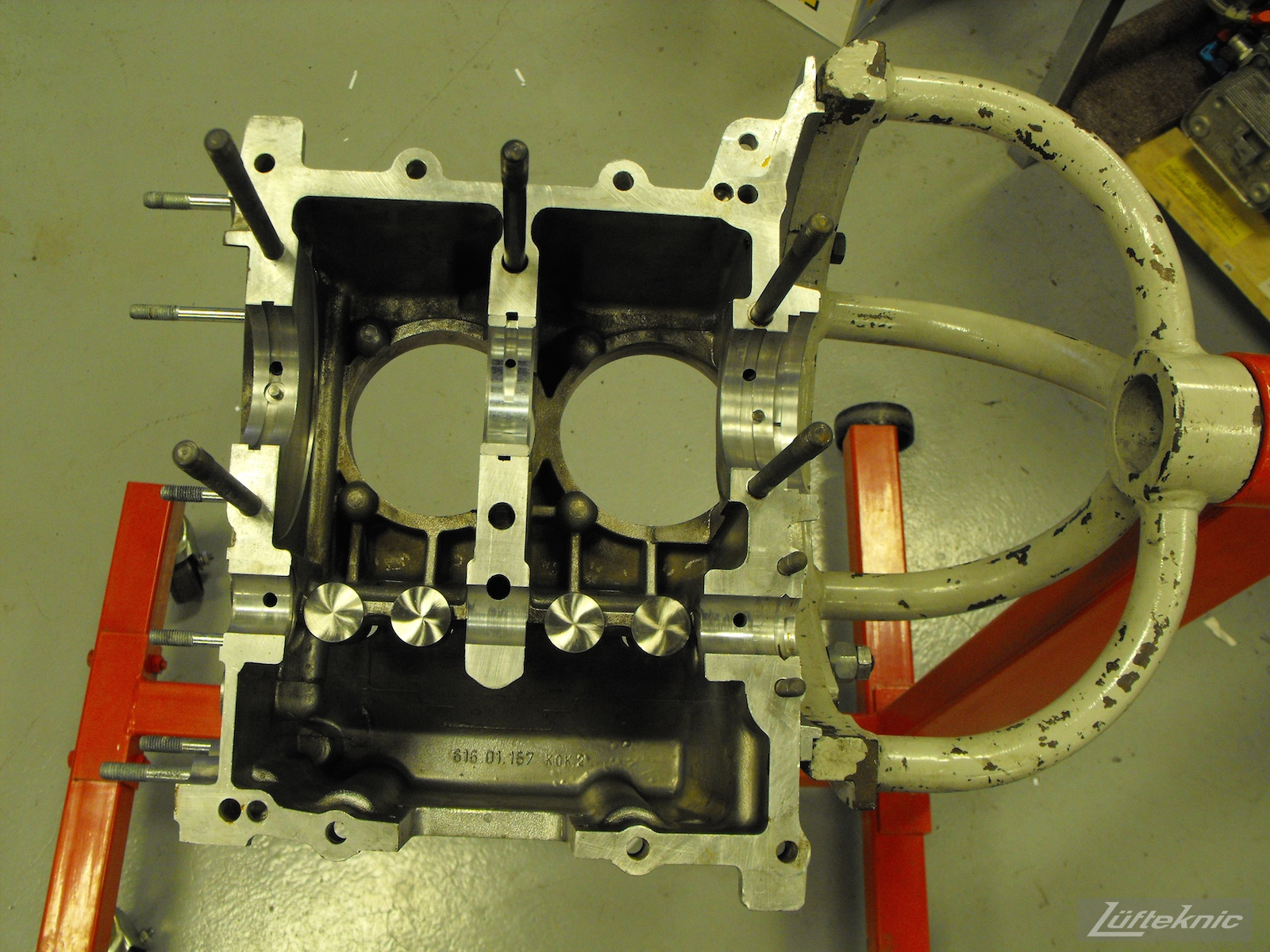 Engine case on a stand for a 1961 Porsche 356B Roadster restoration.