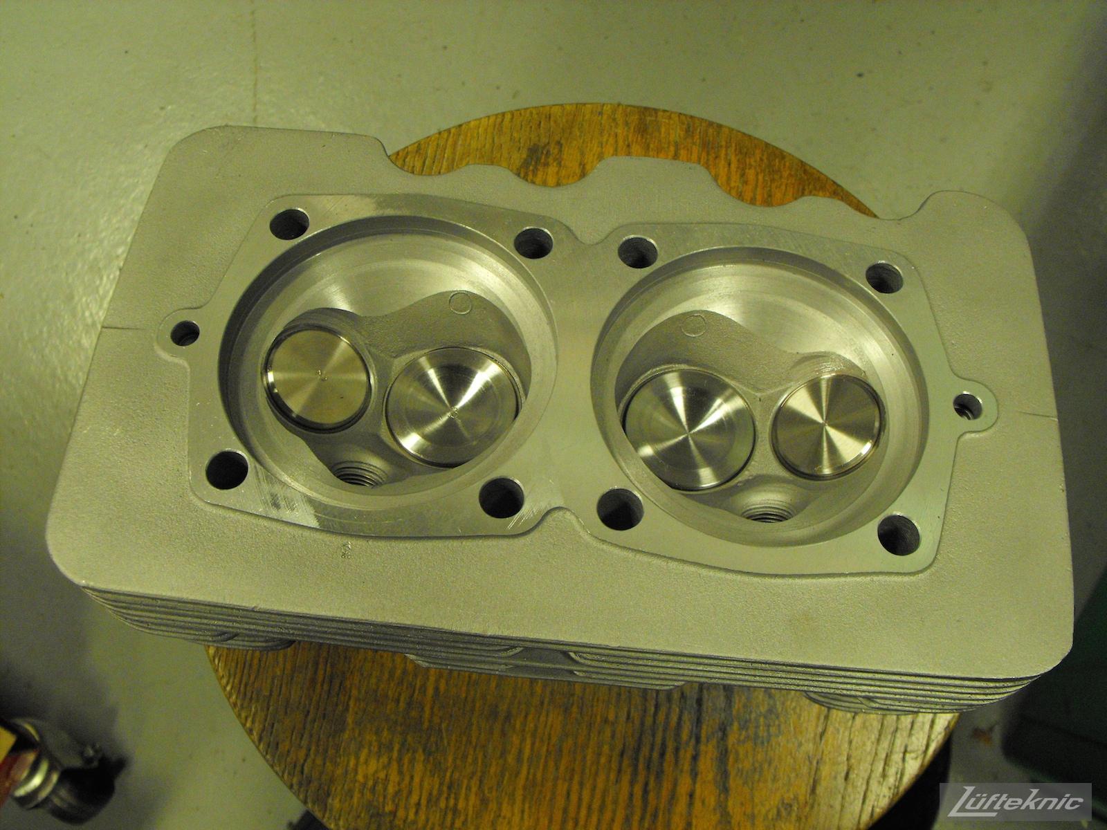 Refinished head showing valves for a 1961 Porsche 356B Roadster restoration.