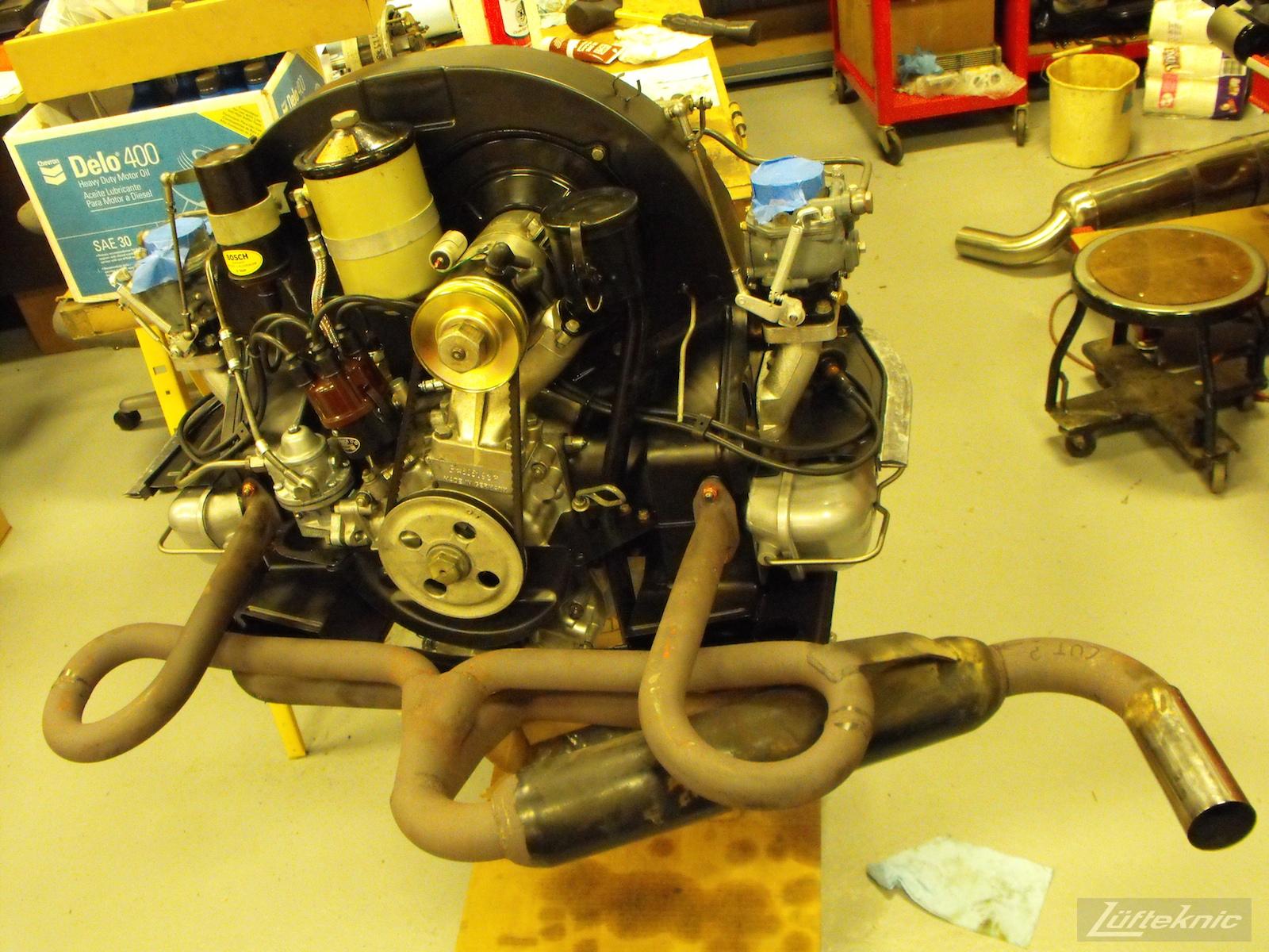 Engine with muffler for a 1961 Porsche 356B Roadster restoration.