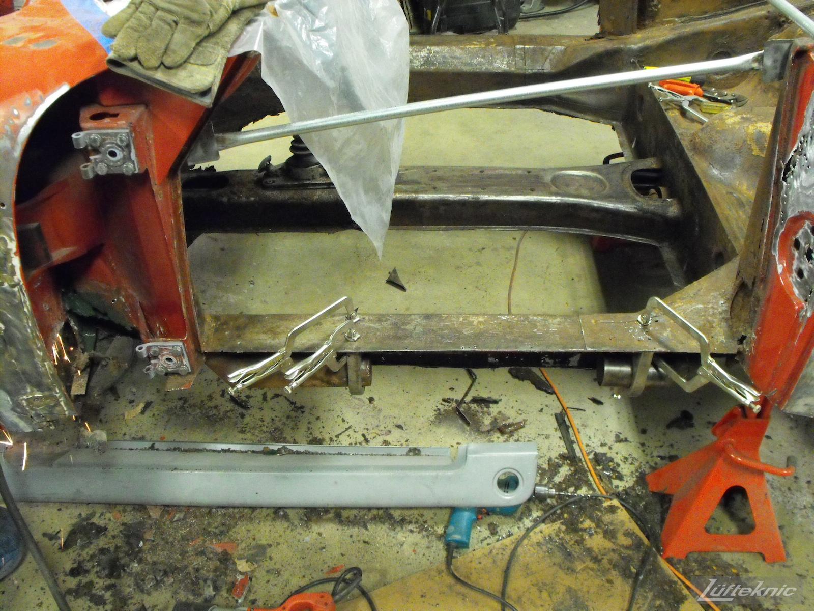 Rust and floors cut away on a 1961 Porsche 356B Roadster restoration.