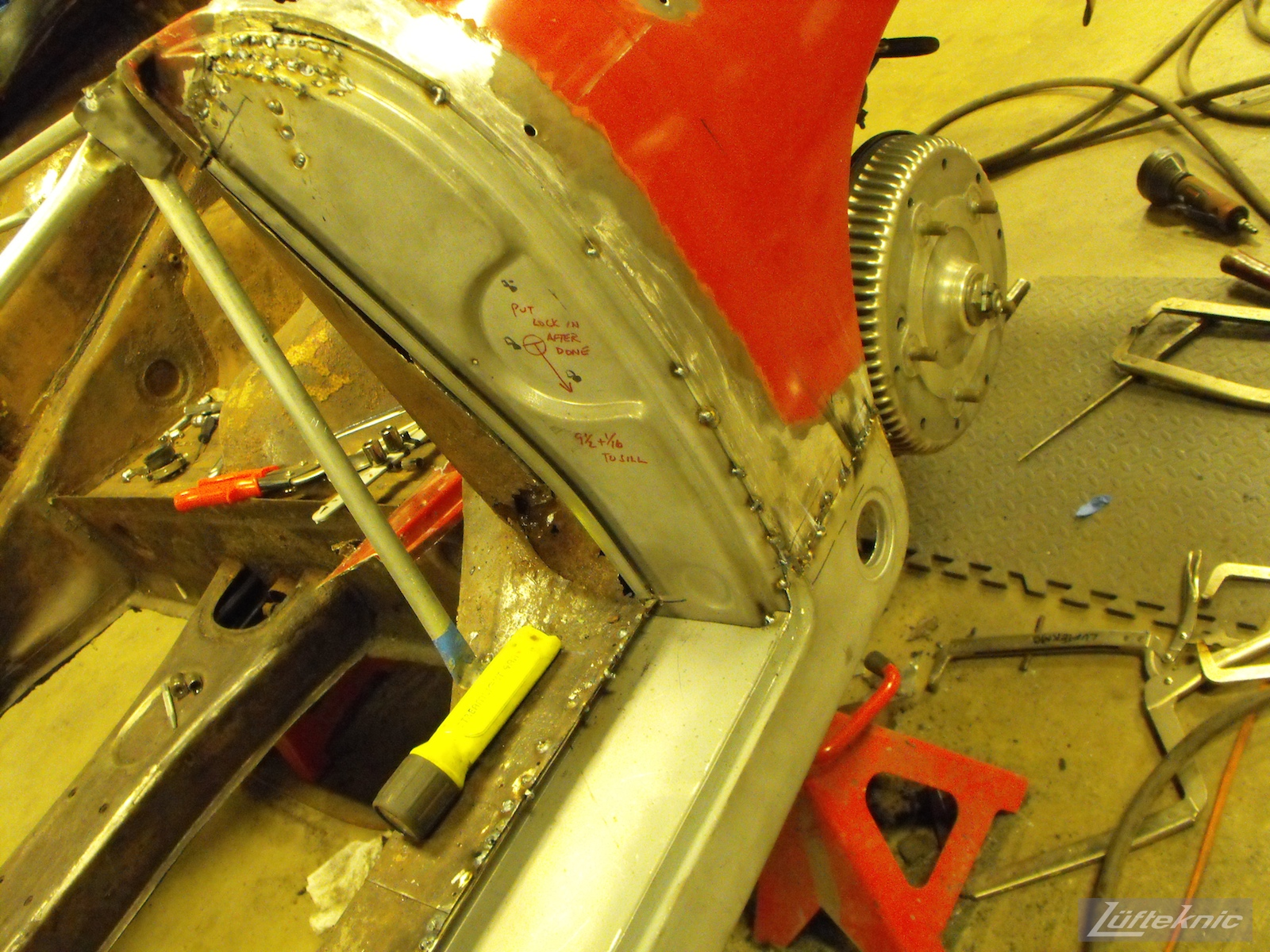 New panels welded into place on a 1961 Porsche 356B Roadster restoration.