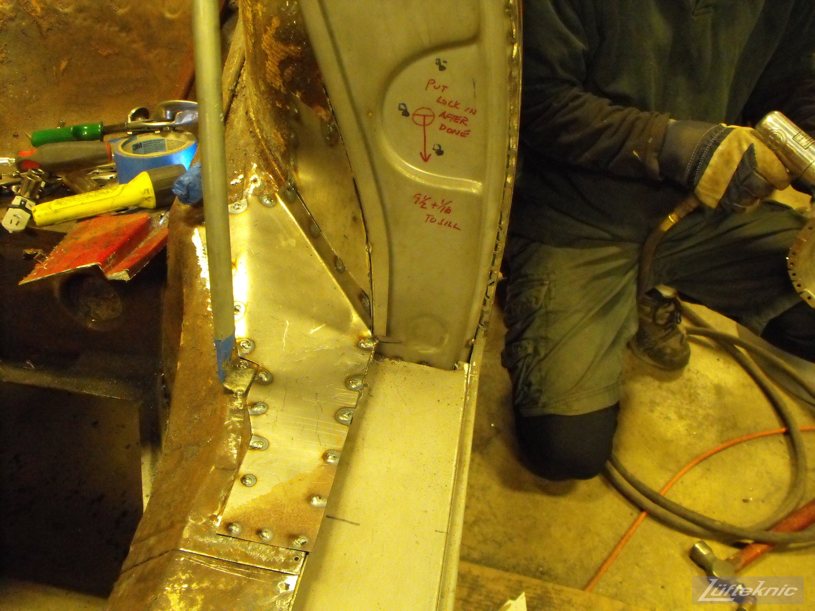 Door latch reconstruction on a 1961 Porsche 356B Roadster restoration.