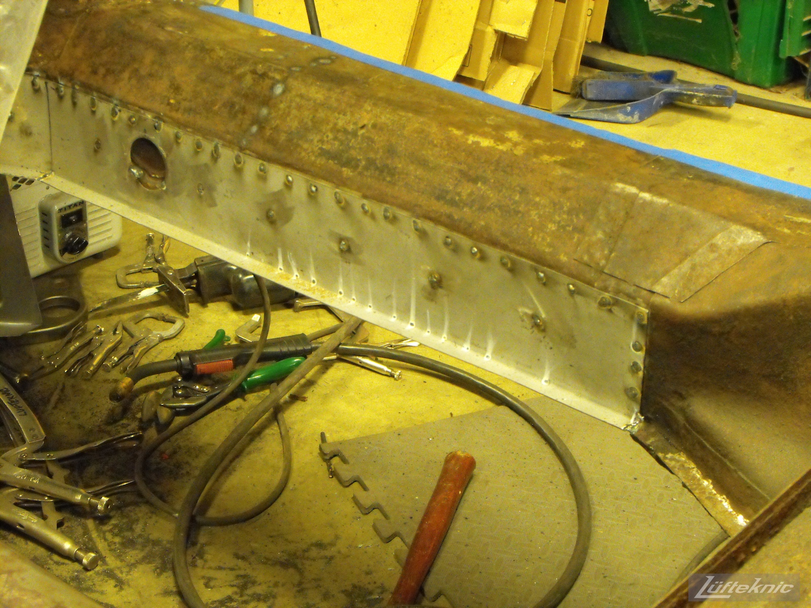 New panel spot welded into the frame on a 1961 Porsche 356B Roadster restoration.