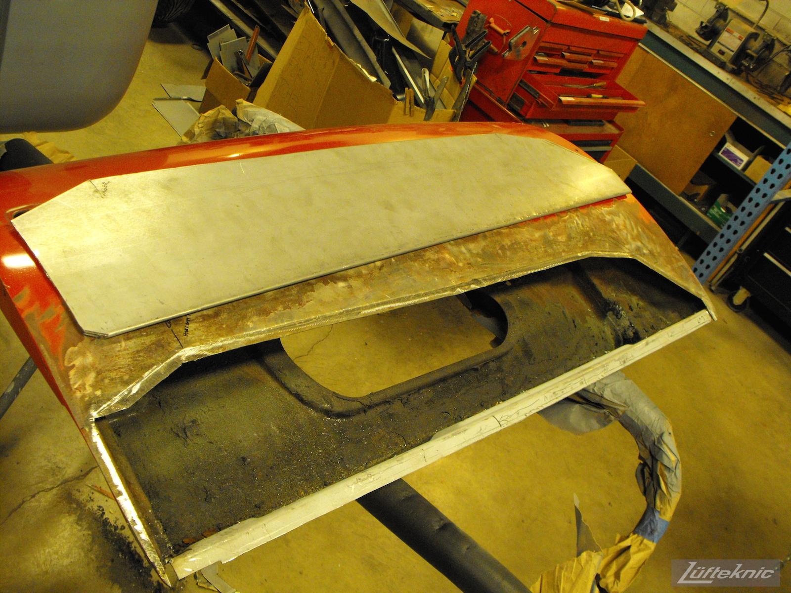 Door repair on a 1961 Porsche 356B Roadster restoration.