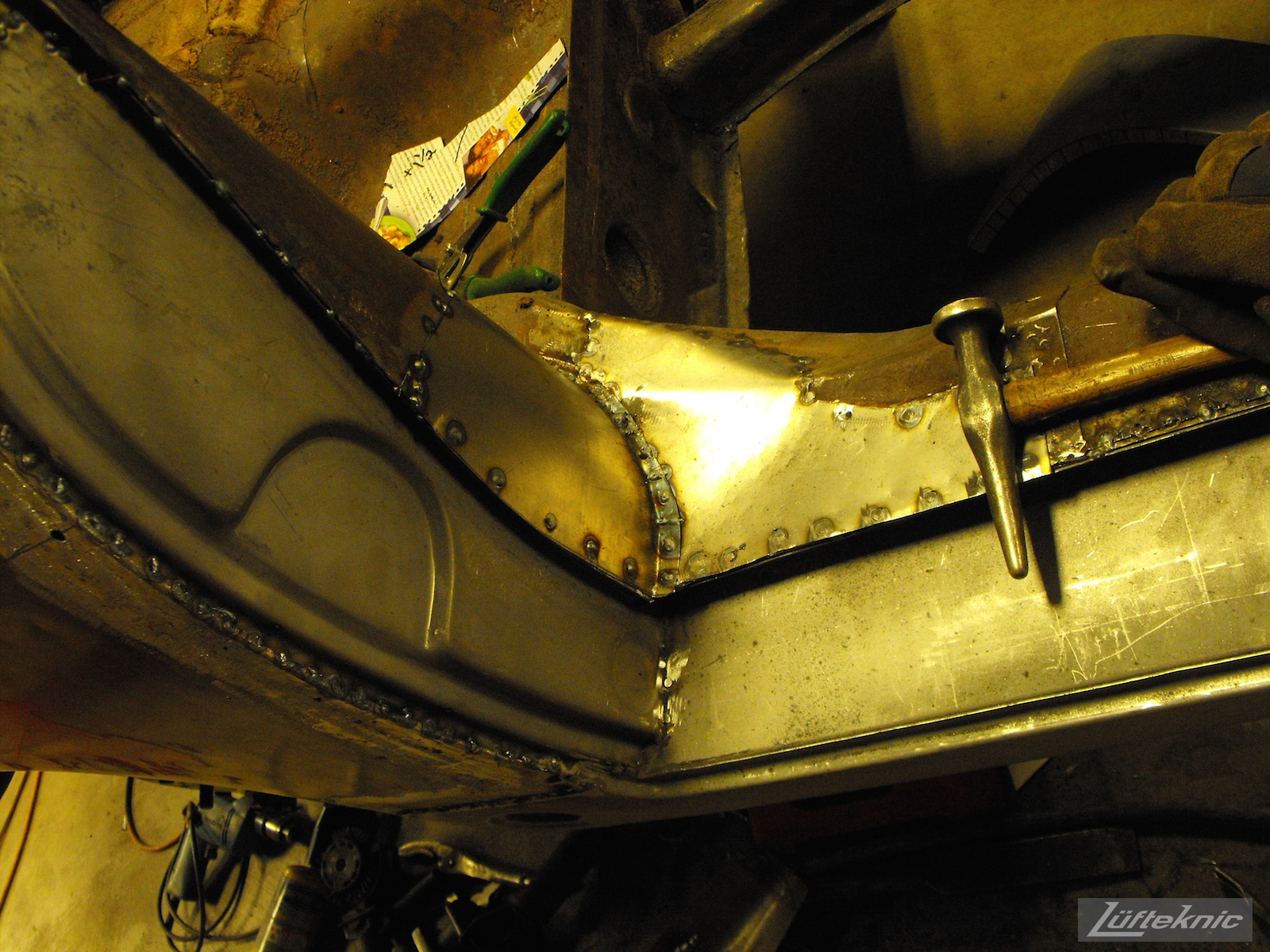 New repair panels welded into place on a 1961 Porsche 356B Roadster restoration.