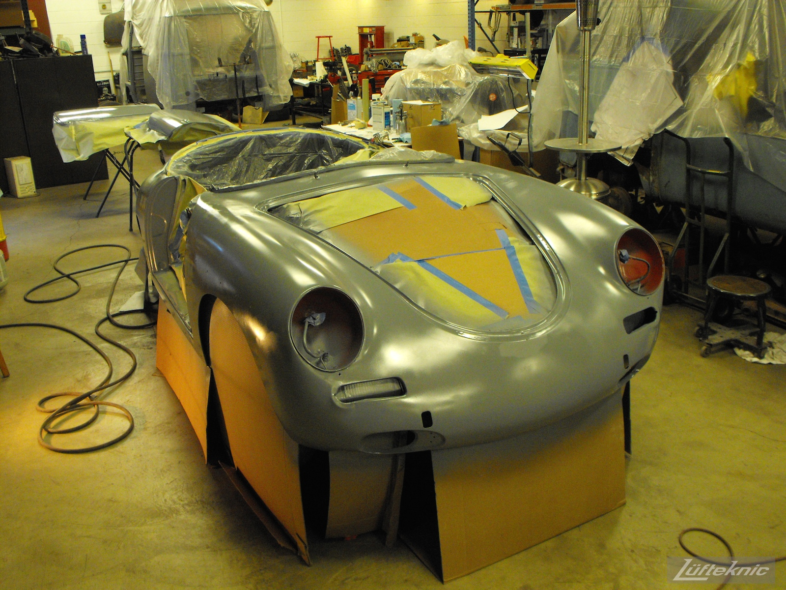 Primered body on a 1961 Porsche 356B Roadster restoration.