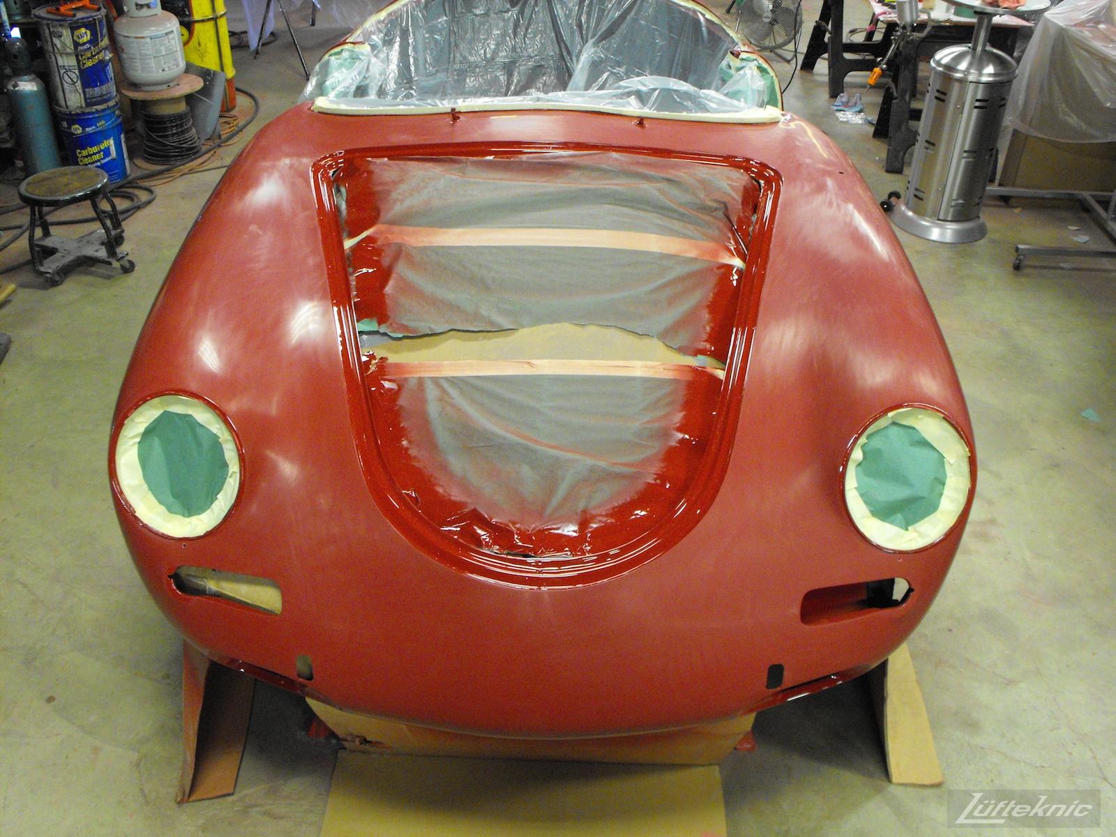 Sanding a 1961 Porsche 356B Roadster restoration.