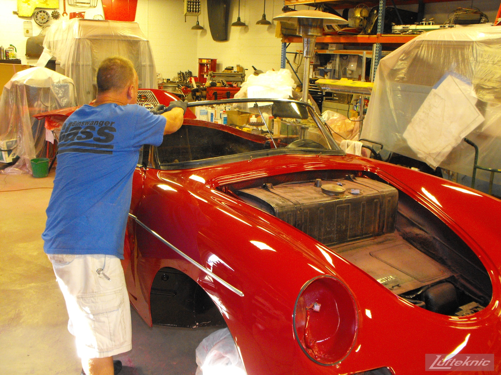 Windshield installation on a 1961 Porsche 356B Roadster restoration.