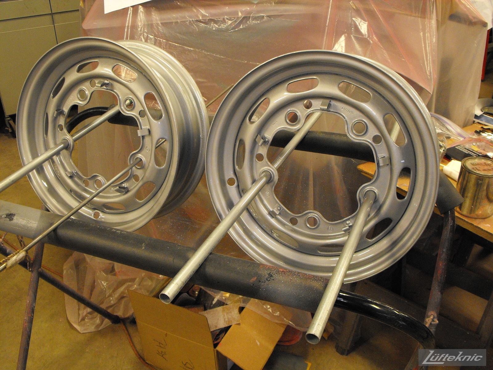 Freshly painted wheels on a 1961 Porsche 356B Roadster restoration.