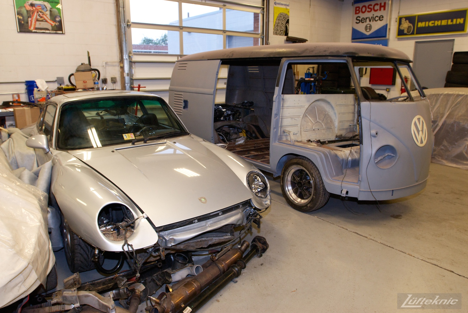 1956 Volkswagen double panel Transporter Porsche Bus with engine installed next to donor car.
